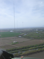 Alpha Jet collecting greenhouse gas measurements above the sampling towers in Walnut Grove, CA