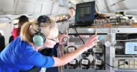 Student operates Whole Air Sampler on NASA DC-8