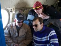 The DMS expert explains the instrument to teachers-in-the-field accompanying the IceBridge flight