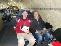 Teachers Mark Buesing and Jette Poulsen aboard the NASA P-3B during an IceBridge survey flight