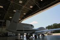 Technicians securing NASA's Global Hawk unmanned aircraft in the aircraft hangar