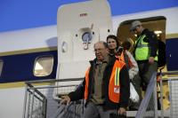 Ambassador Wolff and Ms. Jinnette exiting the DC-8 after another successful IceBridge survey flight.