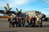 The ARISE research team lines up in front of the NASA C-130 at Eielson Air Force Base, Alaska, for a group photo