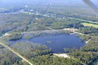 Aerial photo of a 25-acre sinkhole that formed unexpectedly near Bayou Corne, La., in Aug. 2012. Image Credit:  On Wings of Care, New Orleans, La.