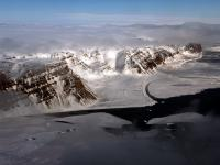 A view of mountains and sea ice near Thule Air Base, Greenland, from the NASA P-3 on May 6, 2014.