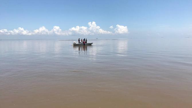 Researchers with NASA's Delta-X mission conduct preliminary field work in coastal Louisiana's delta region. Credits: NASA/JPL-Caltech