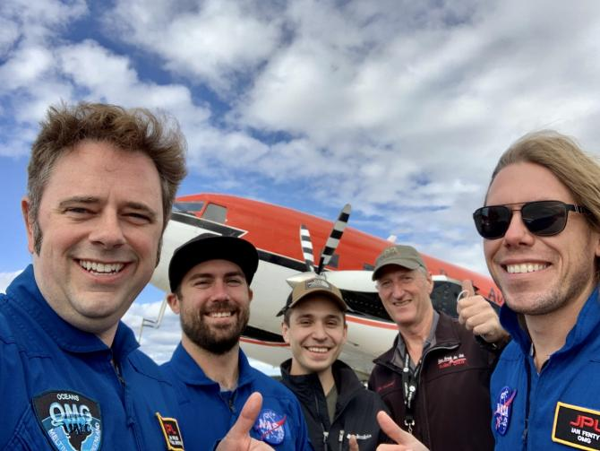 The crew after their successful season. In the photo from left to right: Josh Willis, OMG lead scientist; Mike Wood, OMG scientist; Linden Hoover, Kenn Borek co-pilot; Jim Haffey, Kenn Borek pilot; and Ian Fenty, OMG scientist. Not pictured are Gerald Cirtwell, Kenn Borek flight engineer, and Ian McCubbin, OMG project manager. Credit: Josh Willis/JPL