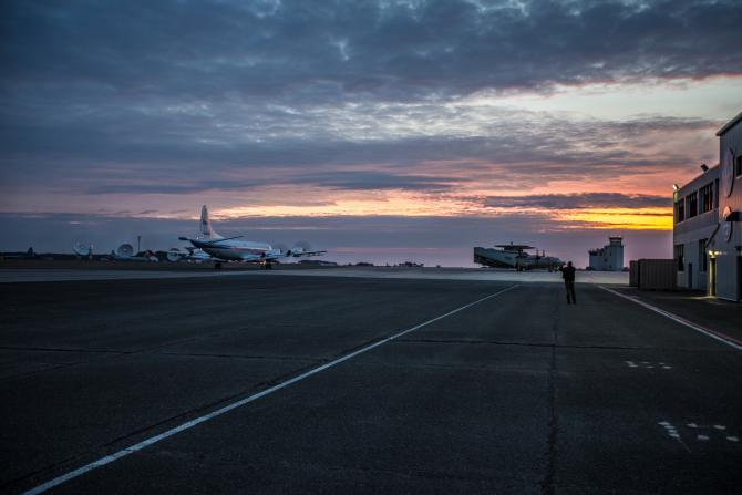 The NASA P-3 Orion aircraft departs the Wallops Facility as the sun rises in the early morning. Credits: NASA/ Patrick Black