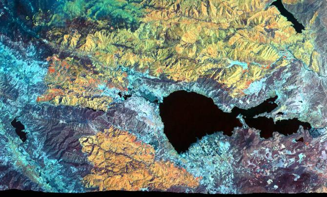The Mendocino Complex Fire is now the largest wildfire in California history with well over 350,000 acres burned. This false-color image was captured on August 9, 2018 by an instrument installed aboard a NASA research aircraft that flew over both fires making up the complex in the area around Clear Lake (the central, black feature) in northern California. Active fire zones are seen in yellow, with warm, burned areas in orange. Unburned vegetation appears in blue and green. The flames of small, active fires