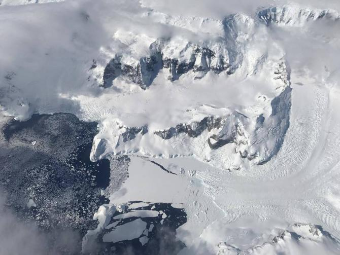 Sea ice forming off the edge of Nobile Glacier on the Antarctic Peninsula during Operation IceBridge's first flight of the 2017 Antarctic campaign, on Oct, 29, 2017. Credits: NASA/Nathan Kurtz