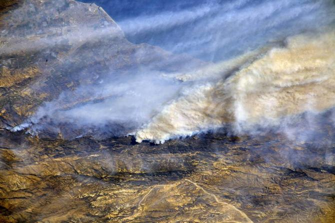 From a Dec. 8, 2017, International Space Station flyover of Southern California, NASA astronaut Randy Bresnik photographed the plumes of smoke rising from wildfires and shared images of the region with his social media followers. Credits: NASA/Randy Bresnik