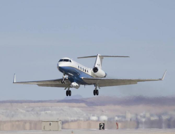 NASA's C-20A research aircraft takes off with the UAVSAR instrument attached below during an earlier flight from Edwards Air Force Base near Palmdale, California. Credits: NASA