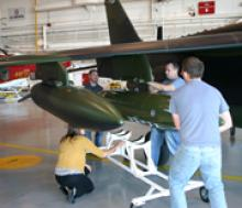 AJAX Team mounting pod onto Alpha Jet