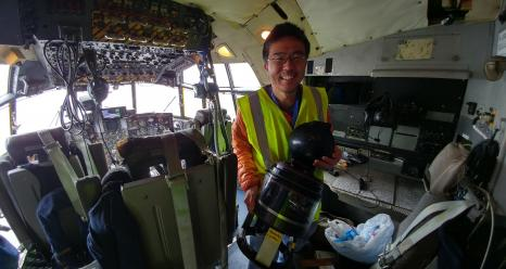 Yohei holding 4STARB in the NASA C130 cockpit during NAAMES-3