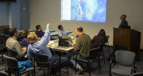 Researchers review proposed IceBridge flight lines during mission's science team meeting at NASA Goddard