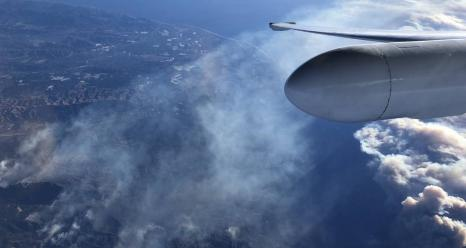 NASA's ER-2 aircraft, based at Armstrong Flight Research Center in Palmdale, California, flies above the Thomas Fire in Ventura County, California, on Dec. 7, 2017. The aircraft was equipped with instrumentation to observe and measure everything from smoke aerosols to the combustion process as fuel burns and fire temperatures. The ER-2 will also make those observations and more during this year's Fire Influence on Regional to Global Environments and Air Quality (FIREX-AQ) campaign. Credits: NASA/Tim William