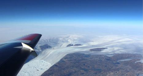 Helheim Glacier, with its characteristic wishbone-shaped channels, as seen from about 20,000 feet in the sky. Credits: NASA/Operation IceBridge