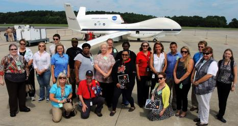Educators visited NASA Wallops Flight Facility on to learn about the HS3 mission, tour the Global Hawk, the Global Hawk Operations Center and meet with HS3 mission personnel.