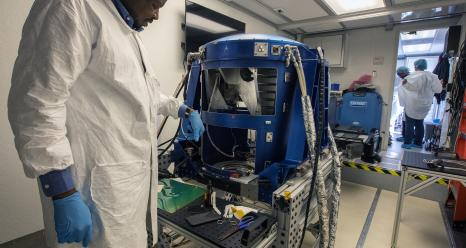 Optical Engineer Aboubakar Traore looks over the Doppler Aerosol Wind Lidar (DAWN) before it travels from Hampton, Virginia, to Palmdale, California. Credits: NASA/David C. Bowman