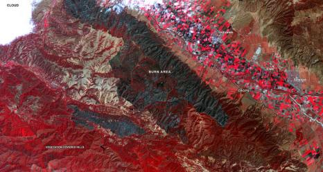 Captured by the ASTER instrument aboard NASA's Terra satellite, this false-color map shows the burn area of the River and Carmel fires in Monterey County, California. Vegetation (including crops) is shown in red; the burn area (dark blue/gray) is in the center of the image. Credits: NASA/METI/AIST/Japan Space Systems