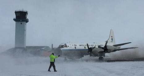 The National Oceanic and Atmospheric Administration's P-3 Orion airplane carrying IceBridge's scientists and instruments gets ready to take off for the Arctic campaign's first research flight from Thule Air Base, Greenland. Credits: NASA/Operation IceBridge/John Woods
