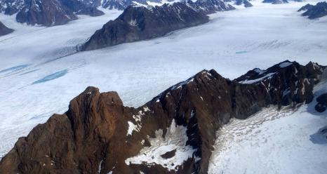 Upper part of Midgard Glacier system in southeast Greenland. Photo taken during NASA's Operation IceBridge Helheim-Kangerdlugssuap Gap B mission on May 17, 2016. Credits: NASA/Maria-José Viñas