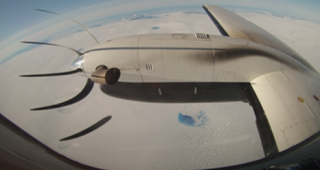 The ICESat-2 mission flew a laser altimeter instrument aboard an aircraft over Greenland in August 2015, to determine how green laser light interacts with different types of snow and ice. (The peculiar appearance of the plane's propeller is an artifact of the way the digital camera records pixels, not all at once when an image is taken.) Credits: NASA/Mike Wusk
