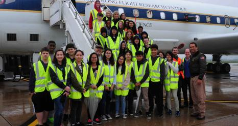 Students from Osan Middle School and Walter Klein (far right) after a tour of the DC-8 at Osan Air Base in South Korea (April 2016). Credits: Emily Schaller / NASA